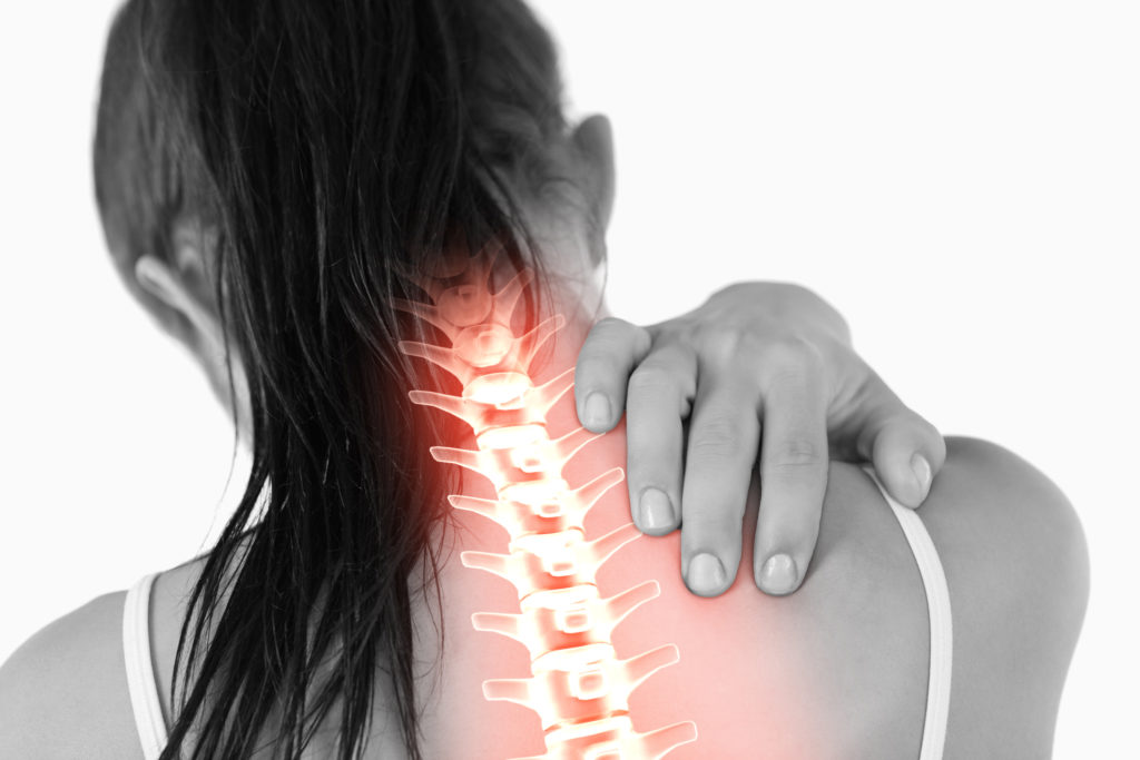 Image of a girl with neck pain.