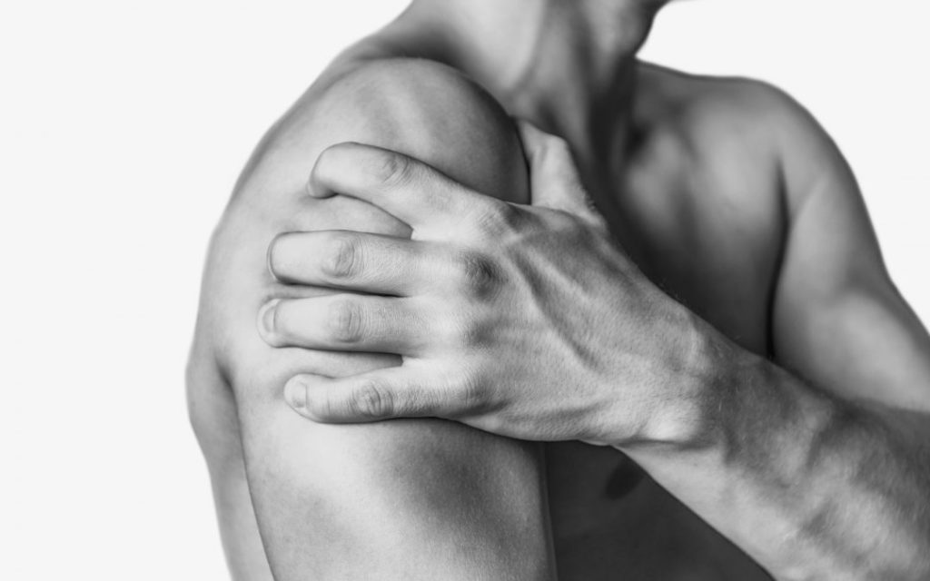 Image of man experiencing shoulder pain
