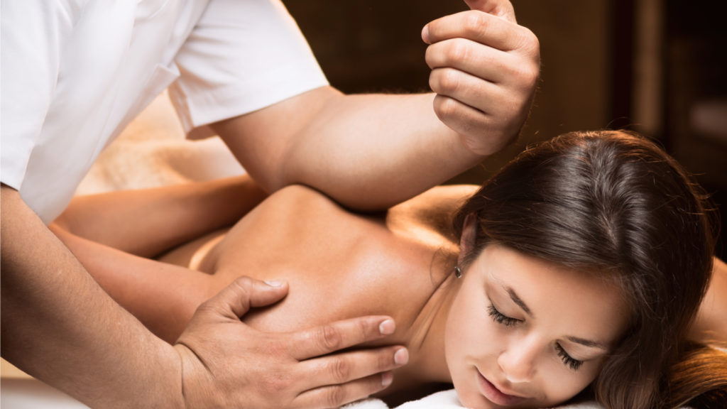 Woman enjoying deep tissue massage
