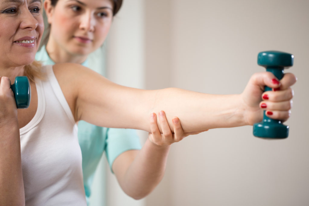 Parkinson's patient exercising with therapist